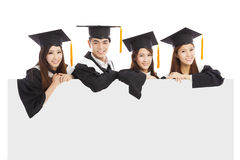 Cheerful young graduate students raise hands Royalty Free Stock Image
