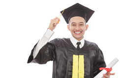 Cheerful young graduated student man holding diploma Royalty Free Stock Images