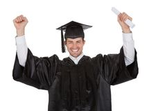 Cheerful young graduation man Royalty Free Stock Image