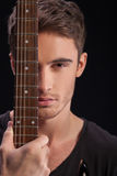 Cheerful young guitarist with a musical instrument Stock Photo