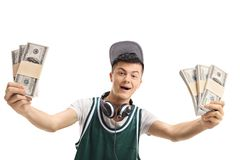 Cheerful young guy with bundles of money isolated. On white background stock image