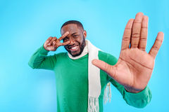 Cheerful young guy gesturing positively Stock Photography