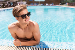 Cheerful Young Guy Having Rest In Pool Outdoor Stock Photo