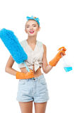 Cheerful young healthy woman is doing housework Stock Images