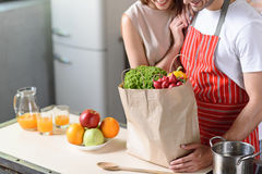 Cheerful young husband and wife ready to cook stock images