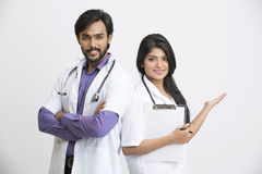 Cheerful young Indian attractive doctors gesturing Royalty Free Stock Images