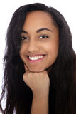 Cheerful Young Indian Woman with Fist on her Chin. Close up Portrait of a Cheerful Young Indian Woman with Long Black Hair Smiling at the Camera with Fist on her Stock Image