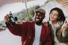 Cheerful young international friends making photos together royalty free stock image