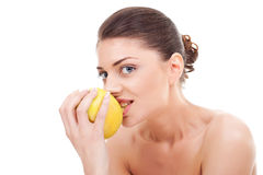 Cheerful young lady eating an apple Stock Photos