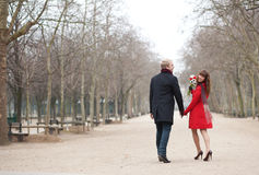 Cheerful young lady with her boyfriend. In a park Stock Photos