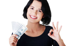 Cheerful young lady holding cash Royalty Free Stock Images