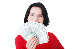 Cheerful young lady holding cash Royalty Free Stock Photography