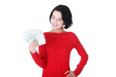 Cheerful young lady holding cash Stock Photo