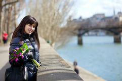 Cheerful young lady in Paris Stock Photography