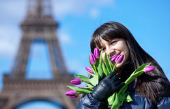 Cheerful young lady in Paris with tulips Stock Images