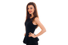 Cheerful young lady with red lips in black dress looking at the camera and smiling isolated on white background Stock Images