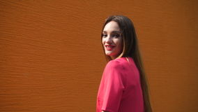 Cheerful young lady with red lips smiling on camera outdoors stock video footage