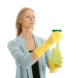 Cheerful young lady spraying cleaner liquid Royalty Free Stock Photos