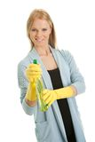 Cheerful young lady spraying cleaner liquid royalty free stock images