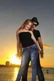 Cheerful young latin couple at sunset Stock Photography