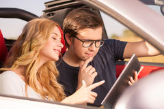 Cheerful young lovers are enjoying their journey Stock Images