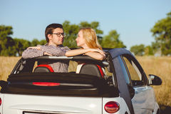 Cheerful young lovers are traveling with joy Stock Images