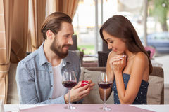 Cheerful young loving couple is celebrating in Royalty Free Stock Images