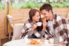 Cheerful young loving couple is enjoying tea in Royalty Free Stock Image