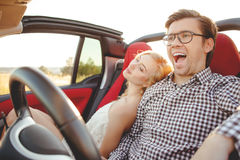 Cheerful young loving couple is enjoying their Royalty Free Stock Photos
