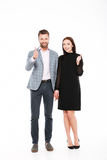Cheerful young loving couple showing thumbs up. Stock Photography