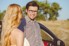 Cheerful young loving couple is traveling by Stock Photography