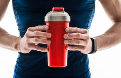 Cheerful young male athlete with fresh beverage Stock Image