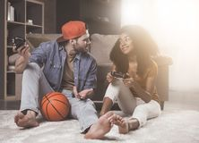 Cheerful young male and female are enjoying video game royalty free stock photography