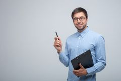 Cheerful young male manager is doing his job Royalty Free Stock Photography
