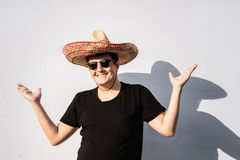 Cheerful young male person in sombrero. Mexico independence fest. Ive concept of man wearing national mexican hat royalty free stock images
