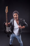 Cheerful young male rocker is evincing negativity Stock Photography