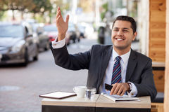 Cheerful young male worker is ready to order in Stock Photo