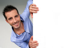 Cheerful young man. Smiling smart guy holding whiteboard Royalty Free Stock Photography