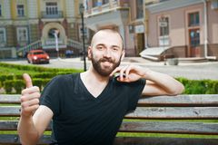 Cheerful young man with beard and positive Royalty Free Stock Photo