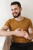 Cheerful young man with a beard Stock Photo