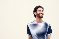Cheerful young man with beard smiling on white background Royalty Free Stock Photography