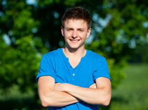 Cheerful young man in blue t-shirt Stock Images