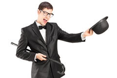 Cheerful young man in a bow tie suit and top hat Stock Images