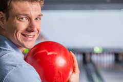 Cheerful young man at the bowling alley Royalty Free Stock Photo