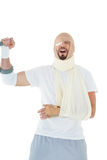 Cheerful young man with broken hand cheering Stock Photography