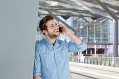 Cheerful young man calling with cell phone Stock Image