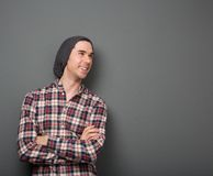 Cheerful young man in checkered shirt Stock Photos