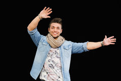 Cheerful young man dancing, moving arms up in the air Royalty Free Stock Photos