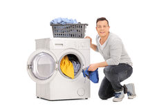 Cheerful young man doing laundry Royalty Free Stock Photo