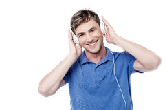 Cheerful young man enjoying  music Royalty Free Stock Photo